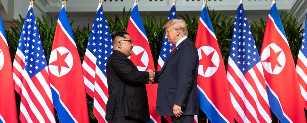 U.S. President Donald Trump shakes hands with North Korean leader Kim Jong Un on June 12, 2018, at Singapore's Capella Hotel in what is the first meeting between a sitting U.S. president and a North Korean leader. White House Photo by Shealah Craighead/UPI Photo via Newscom picture alliance